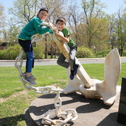 Two boys take a break from the day's activities to climb the Centennial Anchor at the intersection of Center and South Drives. PHOTO: CHIA-CHI CHARLIE CHANG