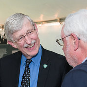 Dr. Roger Glass and Dr. Francis Collins reminisce with Dr. Warren Johnson.
