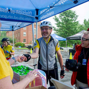 Cyclists collect their T-shirts and other event items. Nate Marchiano (r), whose commute is 13 miles round trip from Four Corners (Silver Spring), bikes to work at the Clinical Center's transfusion services lab about two times weekly. PHOTO: GERALD JORDAN