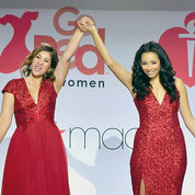 "Go Red for Women ""Real Woman"" Lilly Rocha (r) walks the runway with D.C.'s Karen A. Hill, who is living with cardiomyopathy. PHOTO: GETTY IMAGES/AHA"