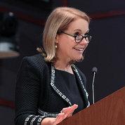 Katie Couric speaking at podium