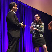 Dr. Sarthak Gupta does a practice interview with Sarah Kaplan onstage.