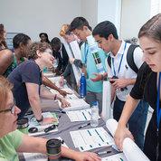 OITE director Dr. Sharon Milgram (c) helps out at the registration table. PHOTO: MARLEEN VAN DEN NESTE