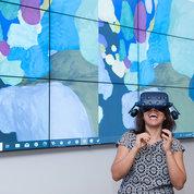 A visitor experiences a zebrafish brain in 3-D. PHOTO: MARLEEN VAN DEN NESTE