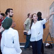 Interns explain their research to their peers. PHOTO: MARLEEN VAN DEN NESTE