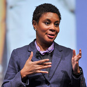 Dr. Alondra Nelson extends her hands during talk