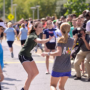 One runner hands off the baton to another runner on Center Drive. PHOTO: MARLEEN VAN DEN NESTE