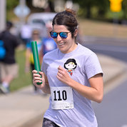 Ana Fernandez-Marino of NINDS's Positively Charged sprints towards the baton exchange zone. PHOTO: MARLEEN VAN DEN NESTE
