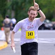 Worktime's Over's anchor runner Matthew Short celebrates his team's first-place finish. PHOTO: MARLEEN VAN DEN NESTE