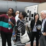 NIH deputy director for intramural research Dr. Michael Gottesman (r) visits the festival poster session on the FAES Terrace. PHOTO: CHIA-CHI CHARLIE CHANG