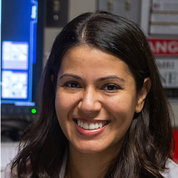 A smiling Dr. Eleni Frangos in the lab