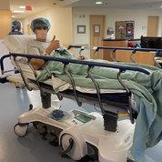 Luke Schmaedeke gets wheeled into surgery at NIH.