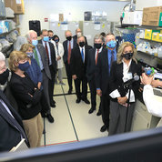 VRC director Dr. John Mascola (r), describes research on a tour of a Vaccine Research Center lab. PHOTO: CHIA-CHI CHARLIE CHANG