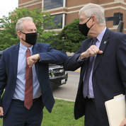 U.S. Sen. Chris Van Hollen (D-MD), arriving on campus, bumps elbows with NIH director Dr. Francis Collins. PHOTO: CHIA-CHI CHARLIE CHANG